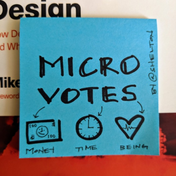 Sticky note with micro-votes written on it with a sharpie marker